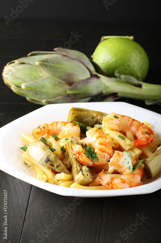 Fotografering  Pasta with shrimp and artichokes