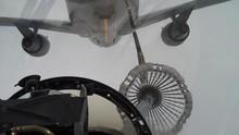 A Fighter Jet Refuels Mid-flig...
