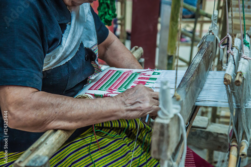 People are weaving; Thailand fabric machine traditional; Asian art manufacturing.