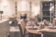Abstract blurry image of dining room interior