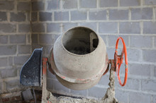 Old Dirty Cement Mixer At A Construction Site.