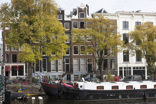 Photo  Houseboats and canal houses in Amsterdam