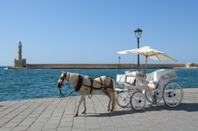 Horse Carriage For Transporting Tourists In Old Port Of Chania On Crete