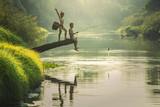 Azjatycki chłopiec połów przy rzeką - 124358200