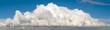Leinwandbild Motiv Blue sky with big fluffy cumulus cloud wide panoramic background