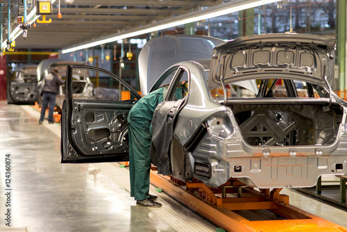 Obraz The production line for the assembly of new vehicles - fototapety do salonu