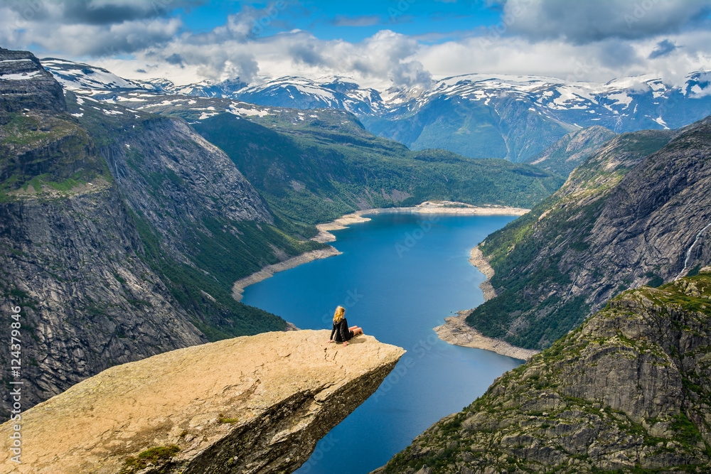 Fototapety, obrazy: Amazing view with Trolltunga and a girl sitting on it. Norway