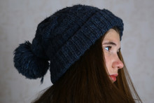 Teenage Girl In Knitted Blue Hat With Pompom