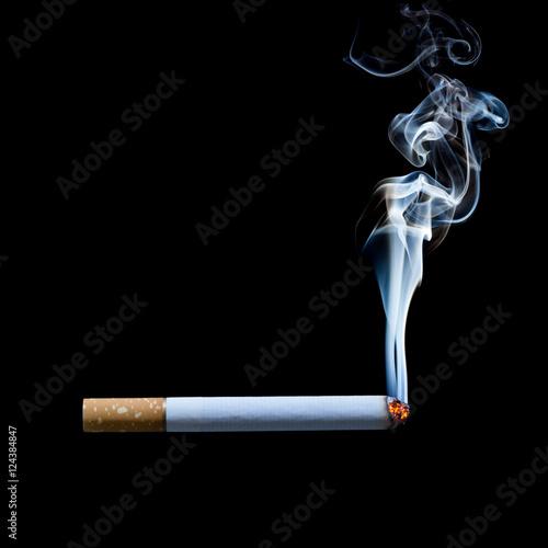 Fotografia, Obraz  smoking cigarette on black background