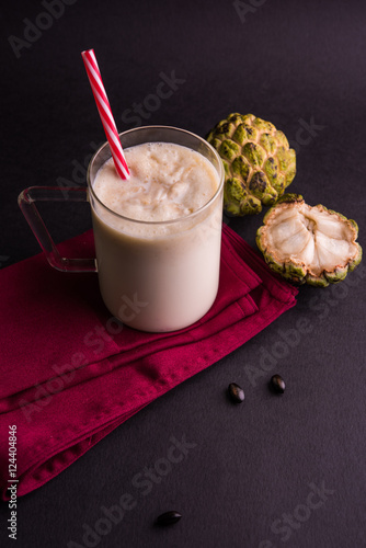 Foto op Plexiglas Milkshake custard apple milk shake. Custard apple or sitafal pulp blended with milk. sitafal milkshake