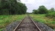 Walk along abandoned railway beside the forest in first person view