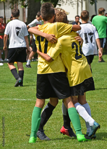 Fotografiet  Young soccer players won the match