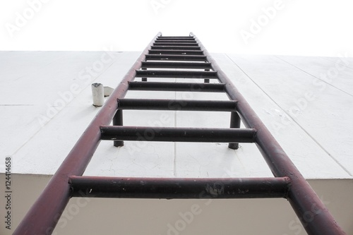 Old vertical industrial metal rusted ladder. Staircase to Water