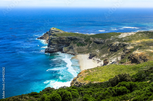 Fotografering  The Cape of Good Hope, South Africa, looking towards the west, from the coastal cliffs above Cape Point, overlooking Dias beach