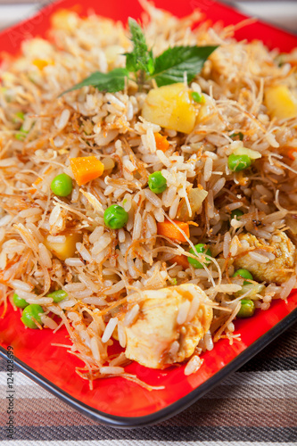 Photo  Chicken Biryani, typical indian food recipe, cooked, shot from a