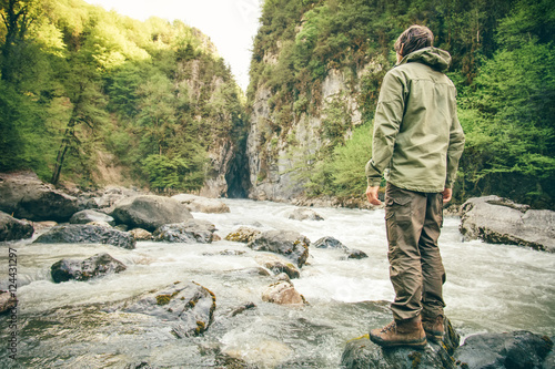 Fotografie, Obraz Young Man hiking outdoor Lifestyle Travel survival concept river and rocky mount