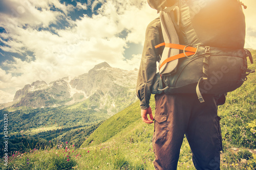 Obraz na płótnie Traveler Man with backpack mountaineering Travel Lifestyle concept mountains on