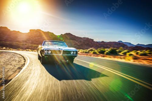 Obraz na plátne  driving fast through desert in vintage hot rod car