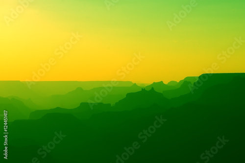 Foto op Plexiglas Groene Panoramic View of Grand Canyon in yellow and green colors after sunset