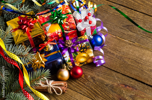 Fototapety, obrazy: Christmas presents with christmas decorations on wooden backgrou