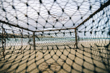 Closeup Rusty Crab Pot On The Sandy Beach. Focus In The Middle
