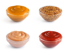 Collection Of Four Different Sauces In Glass Bowls