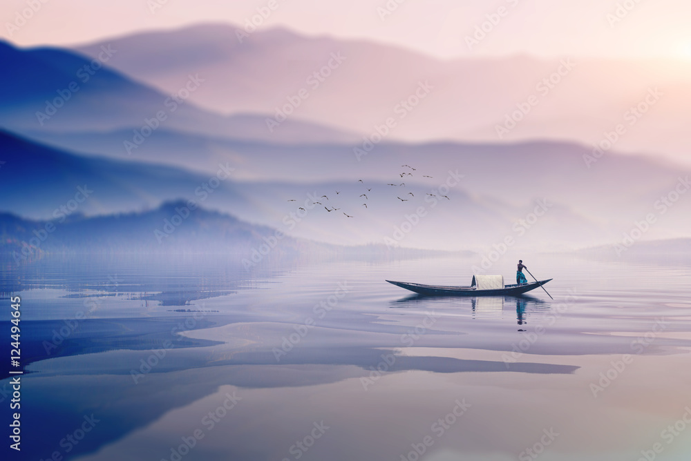 Fototapeta riding boat in the river of bangladesh on dreamy cloudy day