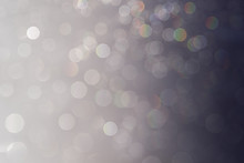 Bokeh Soft Pastel  Grey And White Background With Blurred Rainbow Lights. Festive Background.