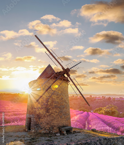 Fotoposter Molens Windmill with levander field against colorful sunset in Provence, France