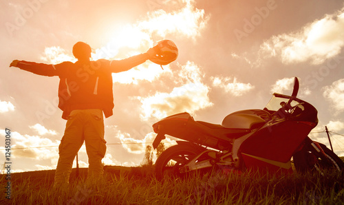 Silhouette of a sport motorbike and biker. Canvas Print