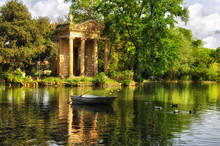 Park Villa Borghese, Rome, Italy. Reflection In Lake With Boat And Ducks