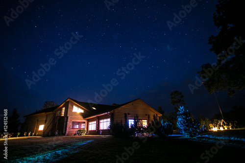 Foto op Canvas Nacht Cottage house at night