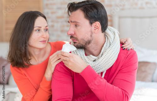 Fotografie, Obraz  Moody miserable man looking at his girlfriend