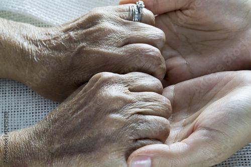 Fotografie, Obraz  Holding Hands
