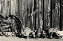Vintage Wild West - Black And White Vintage Wild West Photo Of Horse Saddle And Metal Wagon Wheel