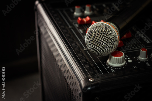 Microphone in soft focus placing on audio synthesiser electronic