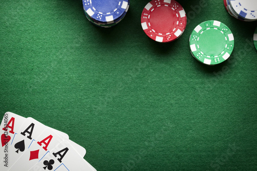 Poker background - chips and cards on green table плакат
