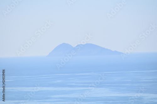 Poster Taupe Isolated Island covered with haze