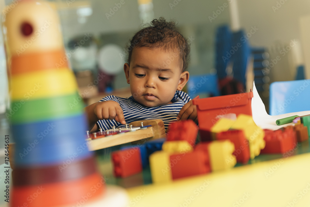Fototapety, obrazy: Happy baby playing with toy blocks.