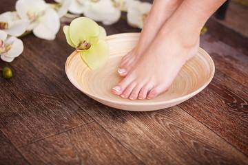 Obraz na płótnie Canvas Female feet at spa pedicure procedure