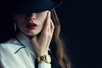 Indoor portrait of a young beautiful  fashionable woman wearing stylish acces...