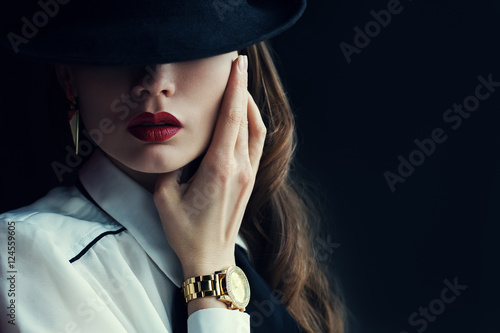 Indoor portrait of a young beautiful  fashionable woman wearing stylish accessories Canvas