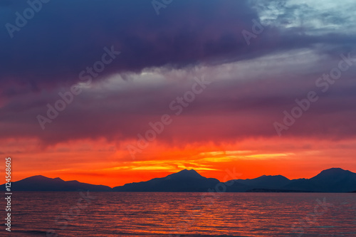 Poster Crimson Colorful sunset over sea in Greece