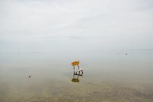 Lonely Broken Chair In Water