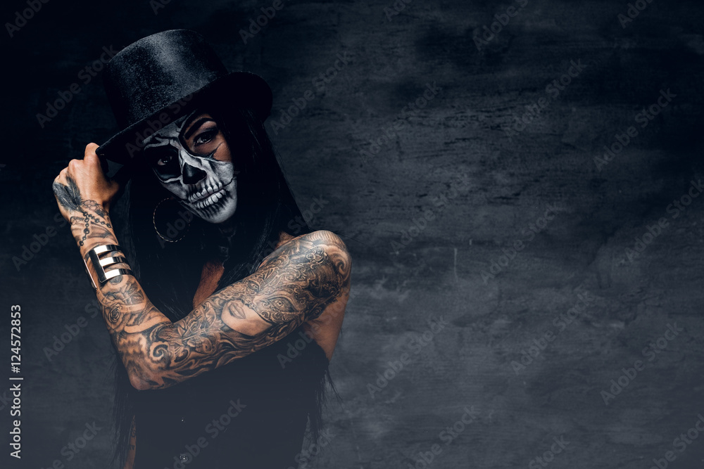 Fototapeta A girl in stylish top hat with skull make up.