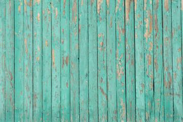 Holzwand mit verwitterter grüner Farbe