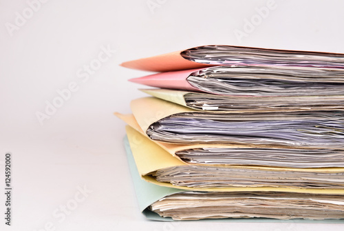 Fototapeta  paperwork Stacked files on isolated background