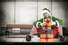 Xmas Time And Elf On Subway Station And Wall Of Free Space