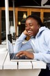 Woman sitting at cafe using laptop