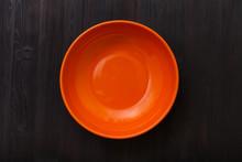 Top View Of Orange Bowl On Dar...